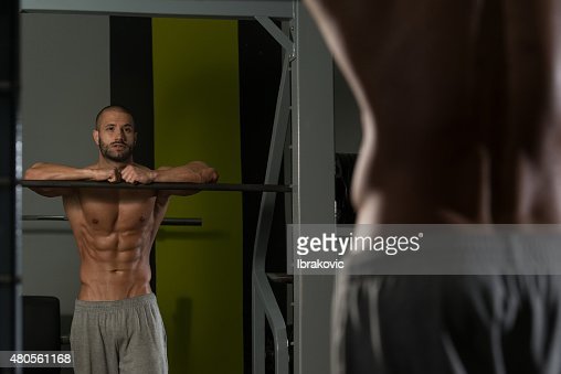 Attractive Young Man Resting Relaxed In Gym : Stock Photo