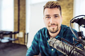Attractive Young Man speaking Into Microphone. Man and podcast host Talking to Microphone.