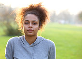 Close up portrait of an attractive young sports woman outdoors
