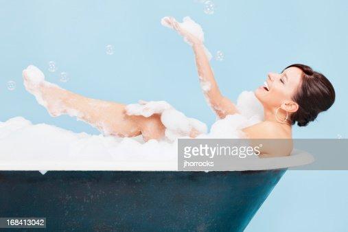 Attractive Young Woman Enjoying a Bubble Bath