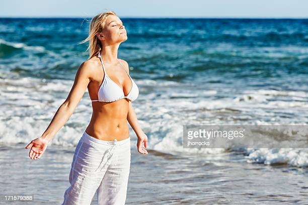 Attractive Young Woman Enjoying a Tropical Breeze