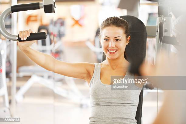 Attractive young woman exercising at the gym.