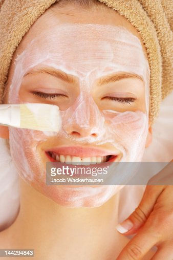 Attractive young woman getting a facial