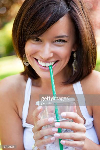 Attractive Young Woman Holding Drink