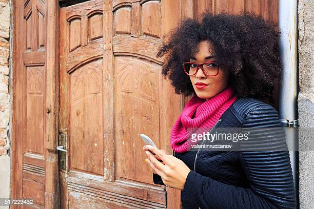 Attractive young woman in front of wooden door