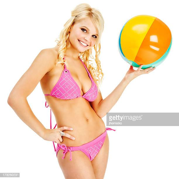 Attractive Young Woman in Pink Bikini with Beach Ball