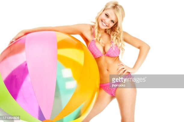 Attractive Young Woman in Pink Bikini with Large Beach Ball