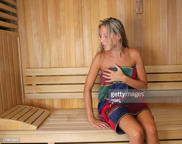 Attractive young woman in sauna