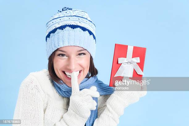 Attractive Young Woman in Sweater with Red Gift Box