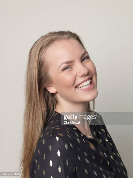 attractive young woman laughing at camera