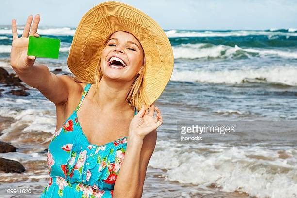 Attractive Young Woman on Vacation with Blank Credit Card