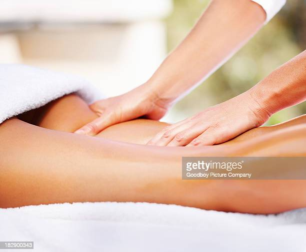 Attractive young woman receiving massage at dayspa