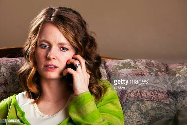 Attractive Young Woman Responds to Alarming Mobile Phone News