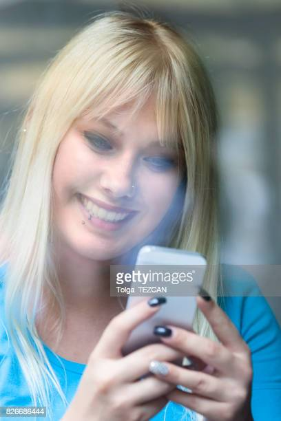 Attractive young woman using smartphone