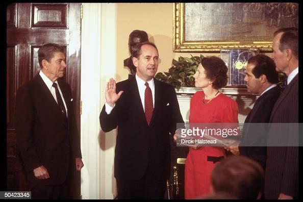 Atty Gen Dick Thornburgh raising hand being swornin by Justice Scalia w wife Virginia holding bible as Pres Reagan VP Bush look on