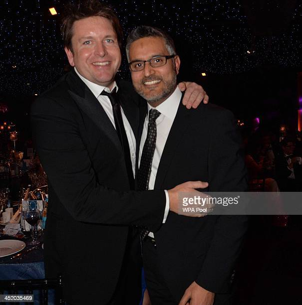 Atul Kochhar of award winning Benares with James Martin attend the British curry awards at Battersea Evolution on November 25 2013 in London England...