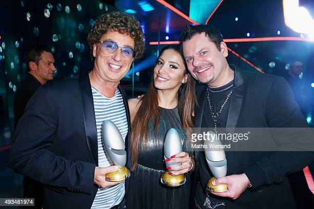 Atze Schroeder Enissa Amani and Ingo Appelt pose with their awards after the 19th Annual German Comedy Awards show at Coloneum on October 20 2015 in...