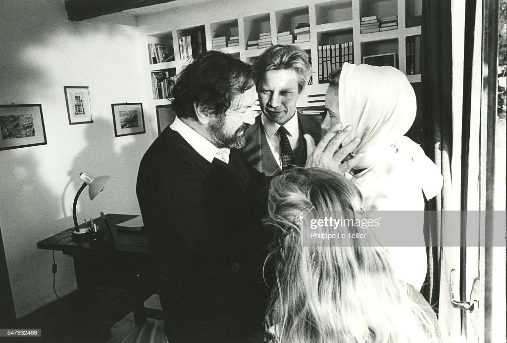 'Au Nom de Tous Les Miens' during filming director Robert Enrico with actors Brigitte Fossey and Michael York 18th October 1982 The movie is based on...
