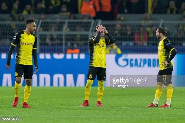 Auba PierreEmerick Aubameyang of Borussia Dortmund Mario Goetze of Borussia Dortmund and Gonzalo Castro of Borussia Dortmund look dejected during the...