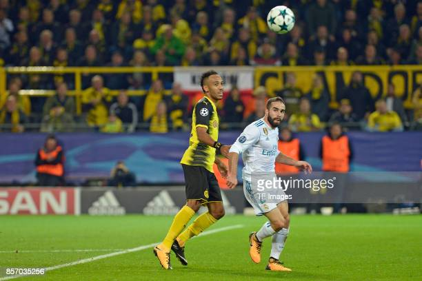 Auba PierreEmerick Aubameyang of Dortmund Daniel Carvajal of Real Madrid battle for the ball during the UEFA Champions League group H match between...