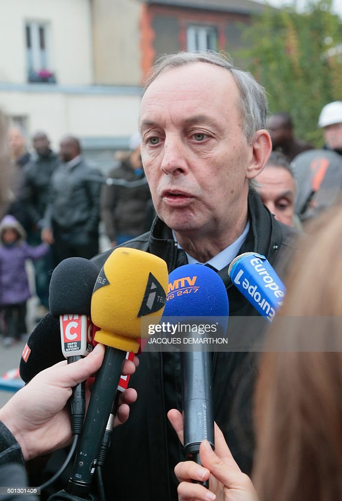 Aubervilliers' mayor Pascal Beaudet answers journalists' questions outside JeanPerrin nursery school on December 14 in Aubervilliers a suburb...