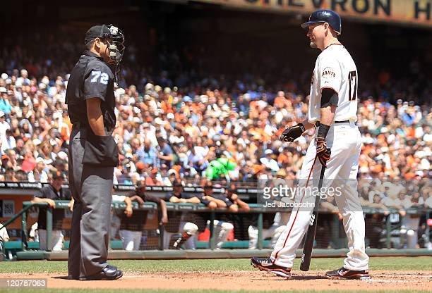 Aubrey Huff of the San Francisco Giants argues with umpire Alfonso Marquez after striking out against the Pittsburgh Pirates at ATT Park on August 10...