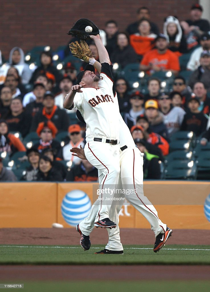 <a gi-track='captionPersonalityLinkClicked' href=/galleries/search?phrase=Aubrey+Huff&family=editorial&specificpeople=208964 ng-click='$event.stopPropagation()'>Aubrey Huff</a> #17 of the San Francisco Giants can't handle a pop up by Ian Desmond of the Washington Nationals during an MLB game at AT&T Park on June 7, 2011 in San Francisco, California.