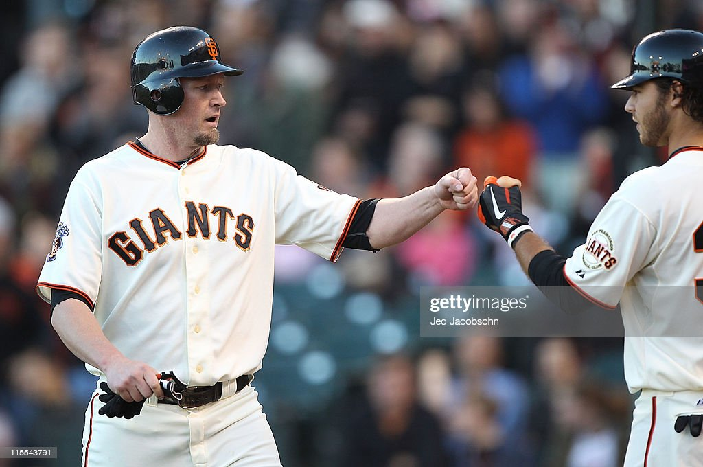 <a gi-track='captionPersonalityLinkClicked' href=/galleries/search?phrase=Aubrey+Huff&family=editorial&specificpeople=208964 ng-click='$event.stopPropagation()'>Aubrey Huff</a> #17 of the San Francisco Giants celebrates with Brandon Crawford #35 of the San Francisco Giants after scoring on a single by Nate Schierholtz against the Washington Nationals during an MLB game at AT&T Park on June 7, 2011 in San Francisco, California.