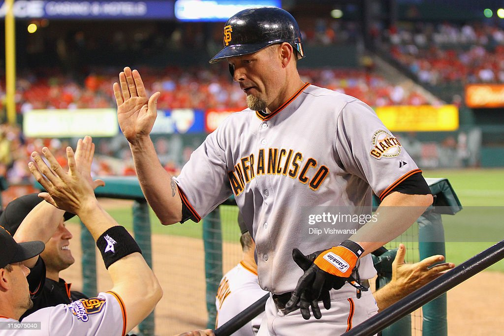 <a gi-track='captionPersonalityLinkClicked' href=/galleries/search?phrase=Aubrey+Huff&family=editorial&specificpeople=208964 ng-click='$event.stopPropagation()'>Aubrey Huff</a> #17 of the San Francisco Giants is congratulated by teammates after hitting a two-run home run against the St. Louis Cardinals at Busch Stadium on June 2, 2011 in St. Louis, Missouri.
