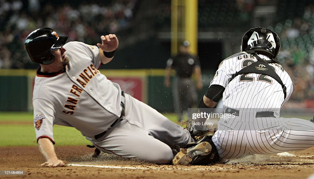 <a gi-track='captionPersonalityLinkClicked' href=/galleries/search?phrase=Aubrey+Huff&family=editorial&specificpeople=208964 ng-click='$event.stopPropagation()'>Aubrey Huff</a> #17 of the San Francisco Giants is tagged out at home plate by catcher Carlos Corporan #22 of the Houston Astros in the first inning> at Minute Maid Park on August 19,2011 in Houston, Texas.