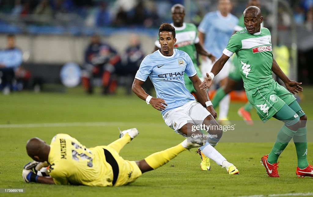 Aubrey Mathibe of Amazulu makes a save of Scott Sinclair of Manchester City during the Nelson Mandela Football Invitational match between AmaZulu and Manchester City at Moses Mabhida Stadium on July 18, 2013 in Durban, South Africa.