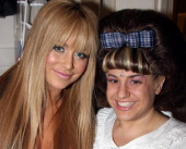 Aubrey O'Day and Marissa Jaret Winokur pose backstage at The 'Hairspray' Closing Night on Broadway at The Neil Simon Theater on January 4 2009 in New...