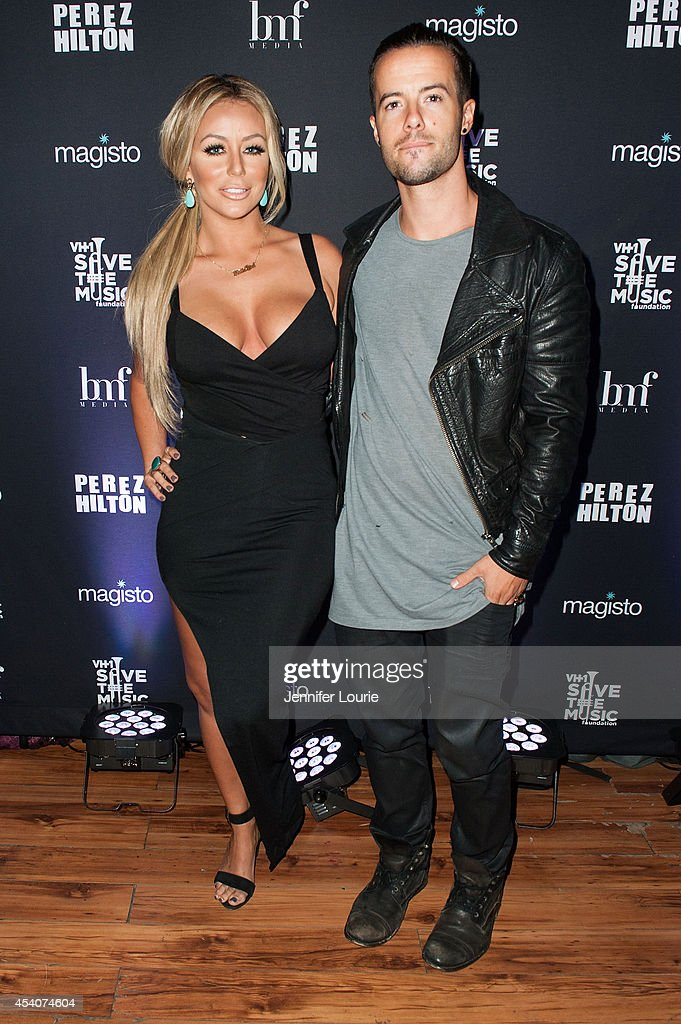 Aubrey O'Day and Travis Garland arrive at 'One Night In Los Angeles' presented by Perez Hilton at The Troubadour on August 23, 2014 in Los Angeles, California.