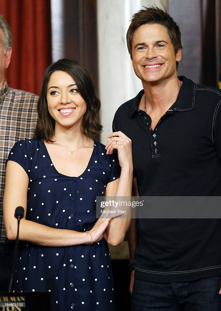 <a gi-track='captionPersonalityLinkClicked' href=/galleries/search?phrase=Aubrey+Plaza&family=editorial&specificpeople=5299268 ng-click='$event.stopPropagation()'>Aubrey Plaza</a> (L) and <a gi-track='captionPersonalityLinkClicked' href=/galleries/search?phrase=Rob+Lowe&family=editorial&specificpeople=211607 ng-click='$event.stopPropagation()'>Rob Lowe</a> attend the 'Parks And Recreation' 100th episode celebration held at CBS Studios - Radford on October 16, 2013 in Studio City, California.