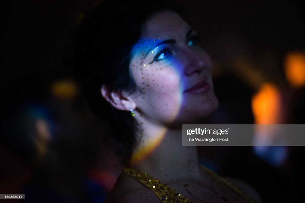 Aubri O'connor, 30, of DC watches one of the many performers at the event. The 2013 Artist's Inaugural Ball featured live music, fire performances, Djs, dancing, a hookah lounge and more. It was spread among six areas in the Rock and Roll Hotel and Gallery O on H. A portion of the proceeds went to local charities, Miriam's Kitchen and One Common Unity. The hosts were Mischief, Rogue Wave Project, Artomatic, and Meso Creso.