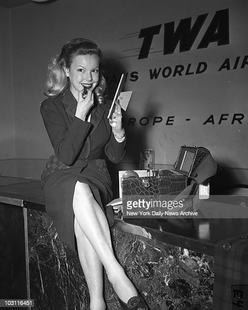 Aubry 19yearold French film star freshens up at LaGuardia Field yesterday The young beauty had just arrived on a TWA plane from Paris She is en route...