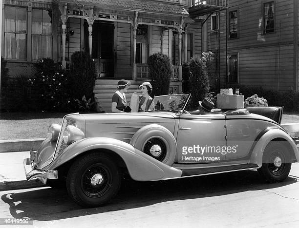 Auburn 8 Convertible Coupe 1934 In a scene from the Columbia Motion Picture White Lies Robert Allen sits in the car while Fay Wray and Irene Hervey...