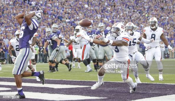 Auburn defensive back Jonathan Jones intercepts a pass that deflected off of Kansas State wide receiver Tyler Lockett left in the end zone during the...