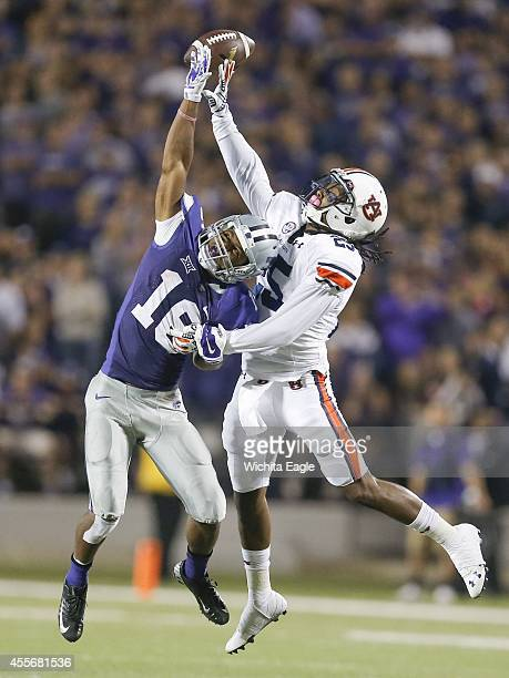 Auburn defensive back Trovon Reed right breaks up a pass intended for Kansas State wide receiver Tyler Lockett during the second half at Snyder...