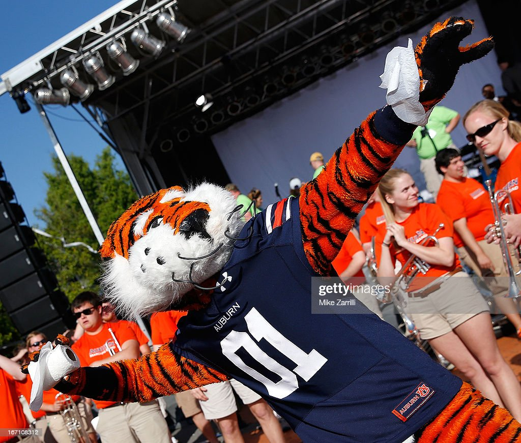 Auburn mascot Aubie throws a roll of toilet paper at the Auburn Oaks during the Toomer's Corner Celebration on April 20, 2013 in Auburn, Alabama.
