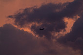 Commercial airliners aviate highways of the sky on a summers eve auburn cloudscape