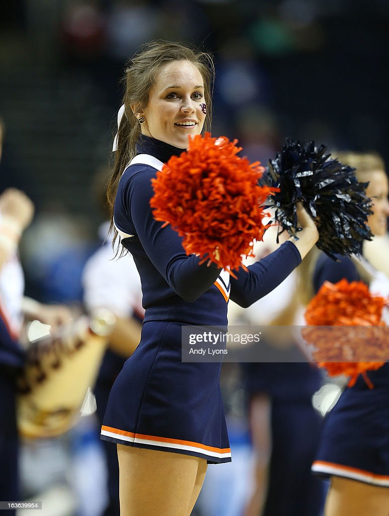 A Auburn Tigers cheerleader performs during the game against the Texas A&M Aggies during the first round game of the Southeastern Conference Tournament at Bridgestone Arena on March 13, 2013 in Nashville, Tennessee.