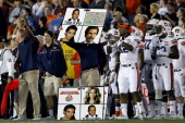 Auburn Tigers coach holds a sign during the 2014 Vizio BCS National Championship Game against the Florida State Seminoles at the Rose Bowl on January...