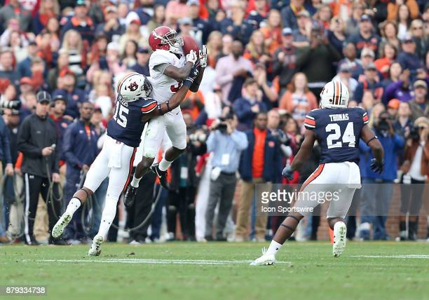 Auburn Tigers defensive back Jordyn Peters breaks up a pass intended for Alabama Crimson Tide wide receiver Calvin Ridley during a football game...