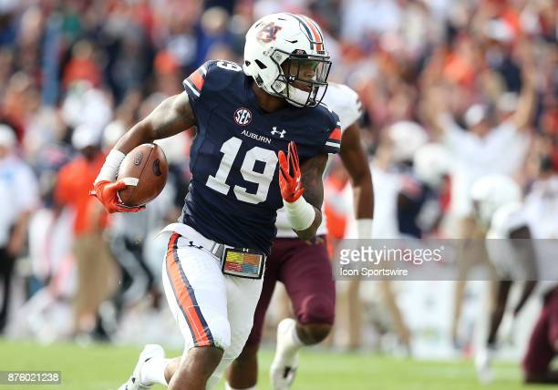 Auburn Tigers defensive back Nick Ruffin returns an interception for a touchdown during a football game between the Auburn Tigers and the...