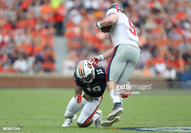 Auburn Tigers defensive back Nick Ruffin tackles Mississippi Rebels tight end Dawson Knox during a football game between the Auburn Tigers and the...