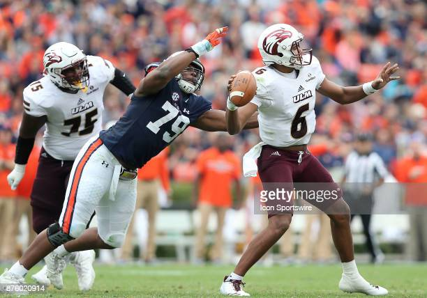 Auburn Tigers defensive lineman Andrew Williams attacks Louisiana Monroe Warhawks quarterback Caleb Evans during a football game between the Auburn...