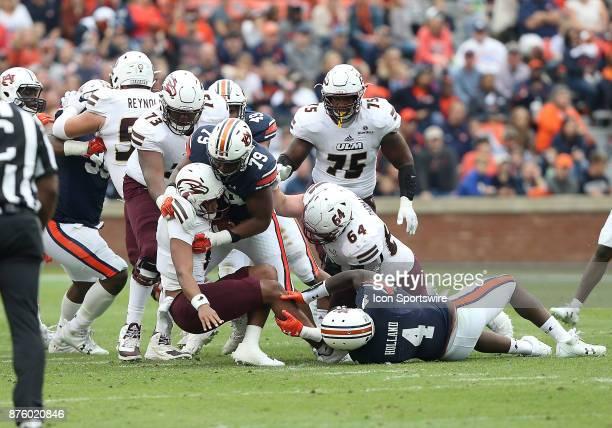 Auburn Tigers defensive lineman Andrew Williams sacks Louisiana Monroe Warhawks quarterback Caleb Evans during a football game between the Auburn...