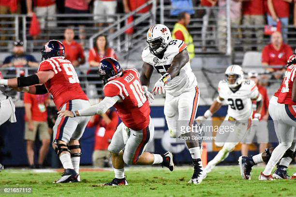 Auburn Tigers defensive lineman Carl Lawson knocks down Ole Miss Rebels quarterback Chad Kelly after a pass attempt during the football game between...