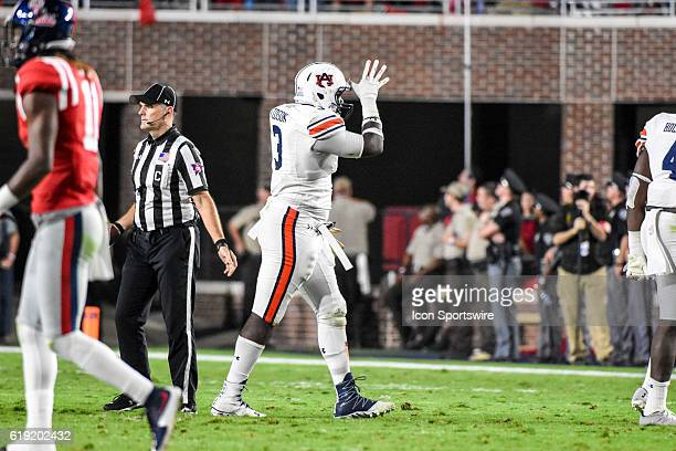 Auburn Tigers defensive lineman Marlon Davidson imitates the Ole Miss 'Land Shark' gesture after stopping Ole Miss on 3rd down during the football...